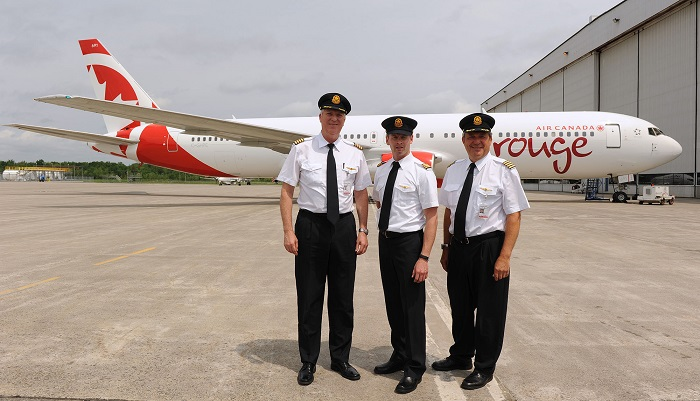 Air Canada rouge now has 3 of its 4 aircraft in it start up fleet with today's arrival of its first B767-300 ER aircraft. The plane was flown from Tel Aviv, where it received a full paint job, by Air Canada pilots: Captain David Lywood, First Officer Kurtis Paproski and Captain John Liska. (CNW Group/Air Canada rouge)